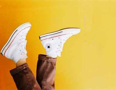 photo of person wearing converse all star sneakers